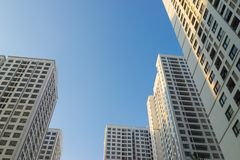 Resident apartment buildings against blue sky. Real estate background.  Stock Photos