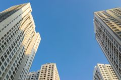 Resident apartment buildings against blue sky. Real estate background.  Stock Photography