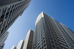 Resident apartment buildings against blue sky.  Stock Photos