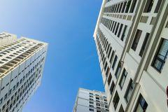 Resident apartment high buildings against blue sky.  Stock Photos