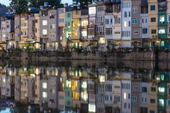 Resident houses with reflection on lake in Hanoi, Vietnam.  Stock Photography