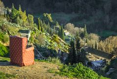 Red arm chair perched on hillside,Sacromonte caves,Granada,Andalucia,Spain stock photography