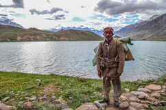 A resident of spiti standing at chandrataal. A local man from spiti standing in front of Chandrataal. Spiti, Himachal Pradesh, India Stock Images