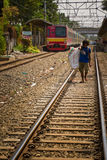Resident of the train track slums of central Jakarta, Indonesia Stock Photos