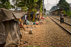 Resident walks the tracks of the train track slums of central Ja Stock Images