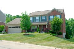 Residential 2-story brick home Stock Photos