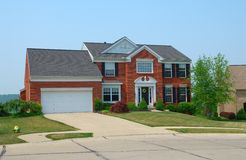 Residential 2-story brick home Stock Photo