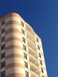 Residential 3. A modern residential building over a blue sky Royalty Free Stock Image