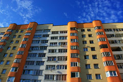 Residential apartment building. Against the blue sky royalty free stock photography