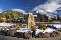 Residential Area Courtyard in Banff Alberta Canada. The Courtyard in front of St. Mary Catholic Church in Banff Alberta and Distant Snowcapped Rocky Mountains in Royalty Free Stock Photos