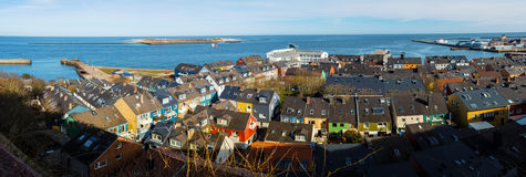Residential area in Heligoland. Panorama of residential area in Heligoland. Top view on roof of traditional colorful holiday homes. Island Helgoland, Germany Royalty Free Stock Images