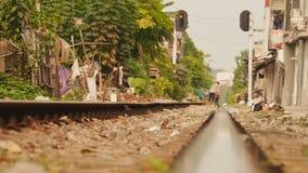 Residential area nearby railways in Hanoi. Runs rat. Vietnam. stock video
