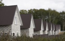 Residential area with newly built houses in a row.  Stock Photo
