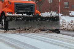 Residential area Snowplow on the road. Snowplow on the road snowing and wind blowing in residential area in the blizzard Stock Photo