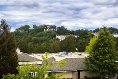 Residential area, south San Francisco bay area, California. Residential areas with houses scattered on hills; Santa Cruz mountains on a cloudy day, Saratoga stock photo