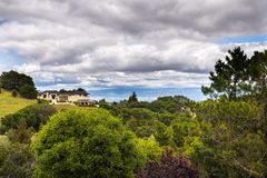Residential area, south San Francisco bay area, California. Residential areas with houses scattered on hills; Santa Cruz mountains on a cloudy day, Saratoga royalty free stock images