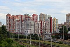 Residential array of multi-storey buildings behind the railway Royalty Free Stock Photo