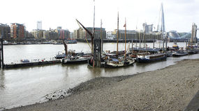 Residential barges on Thames. With London City Hall Shard Tower wiev stock image