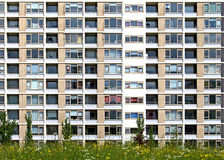 Residential block. Front view detail of facade from apartment building in Europe, example of precast plattenbau royalty free stock photo