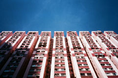 Residential block in hong kong, under blue sky. Housing in hong kong, many families share a same building block Royalty Free Stock Photos