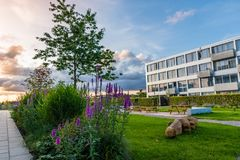 Residential block. In Viby, Denmark with beautiful garden and recreational area at sunset Royalty Free Stock Images
