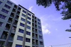 Residential building An apartment with blue sky. And trees Royalty Free Stock Photography