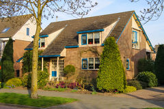 Residential building with a beautiful garden in Meerkerk Stock Photography