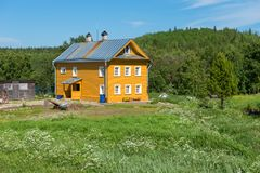 Abbot`s house. Residential building and boulder bath Holy Trinity Anzersky monastery of the Solovki monastery on the Anzersky island, Solovki islands royalty free stock photo