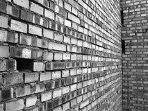 A residential building in a brick wall stock photos