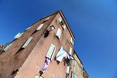 Residential building with drying clothes Stock Photography
