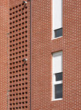 Residential building facade detail with red bricks Stock Photo