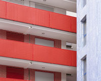 Residential building facade in red and blue tone Royalty Free Stock Image