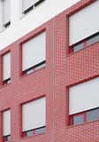 Residential building facade in red and white tone Royalty Free Stock Images