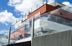 Residential building with glass fence Stock Photo
