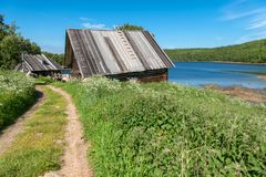 Old house on the bay. Residential building Holy Trinity Anzersky monastery of the Solovki monastery on the Anzersky island, Solovki islands, Arkhangelsk region royalty free stock photo