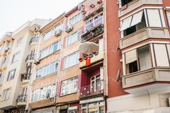 Residential building in Istanbul with balconies decorated with flowers and small Turkish flags. Turkey. Ordinary people Royalty Free Stock Photography