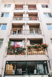 Residential building in Istanbul with balconies decorated with flowers and small Turkish flags. Turkey. Ordinary people Stock Photography