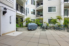 Residential building. Patio area with swimming pool Stock Photography