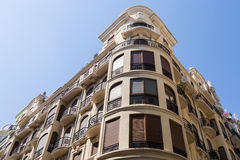 Residential building. Perspective view of a residential building against blue sky. City center of Valencia, Spain Royalty Free Stock Photos