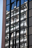 Residential Building Reflection in Windows Stock Photography