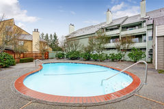 Residential building with swimming pool Royalty Free Stock Photography