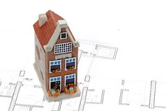 Residential building on top of architect plan Stock Photo