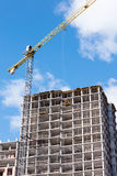 Residential building and tower crane at construction site Stock Photos