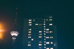 Residential building and tv tower in Berlin at night -. Residential building and tv tower in Berlin at night Stock Images