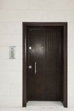 Residential Building Wall With Iron Door And Intercom System Royalty Free Stock Photography