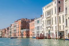 Residential buildings along the embankment of the Grand Canal. In the background, blue cloudless sky. royalty free stock photography