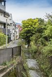 Residential buildings Arashiyama Japan. Residential area with a walkway next to a small stream in Arashiyama. Kyoto prefecture, Japan Royalty Free Stock Photography