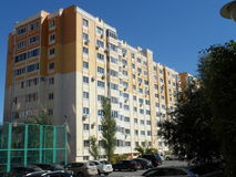 Residential buildings. Astana, some residential buildings near the seafront with football playground and park zone royalty free stock photography