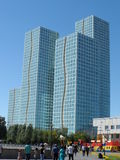 Residential buildings. Astana, some residential buildings near the seafront with football playground and park zone stock photos