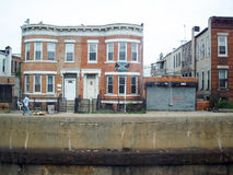 Residential buildings in Brooklyn. NEW YORK CITY, USA - JULY 8 : A street with residential buildings next to a water canal in Brooklyn on July 8th, 2006 in New stock photo